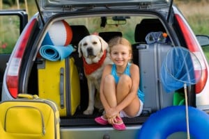 girl and pet dog in car